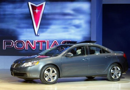 The Pontiac G6 is unveiled January 5, 2004 during press days at the North American International Auto Show in Detroit, MI. REUTERS/Gregory S