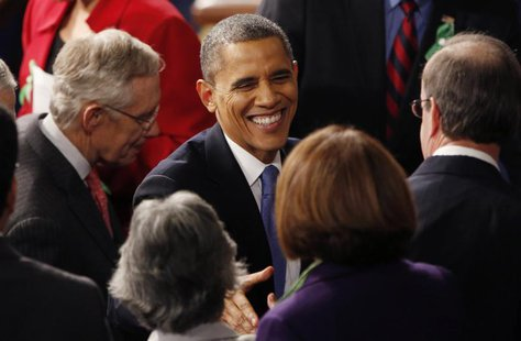 U.S. President Barack Obama talks with members of Congress as Senate Majority Leader Harry Reid (D-NV) (L) departs with him at the conclusio