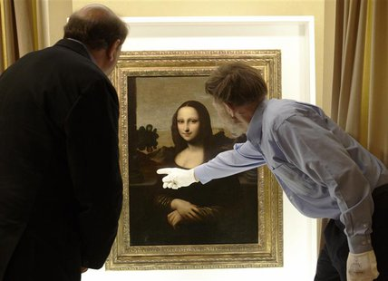 David Feldman (R) , vice president of the Mona Lisa Foundation, shows similarities on a painting attributed to Leonardo da Vinci and depicti