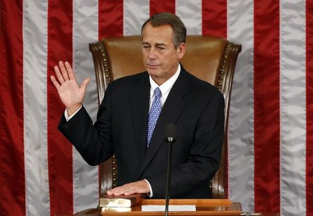 Speaker of the House John Boehner takes his oath during the first day of the 113th Congress at the Capitol in Washington January 3, 2013. RE