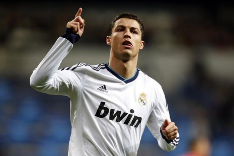 Real Madrid's Cristiano Ronaldo celebrates after scoring his second goal against Sevilla during their Spanish first division soccer match at