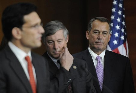 U.S. House Speaker John Boehner (R-OH) (R) listens to Rep. Eric Cantor (R-VA) (L) during a news conference at the U.S. Capitol in Washington