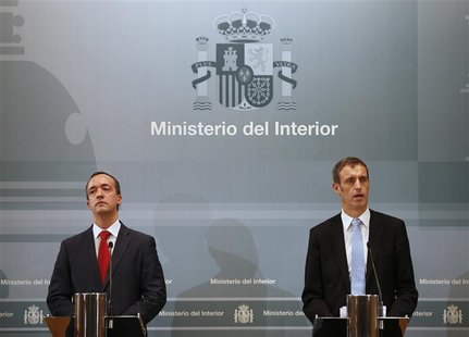 Director of Europol Rob Wainwright (R) speaks next to Spain's Security State Secretary Francisco Martinez during a news conference at the In