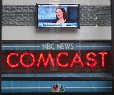 The news ticker outside the Today Show announces GE's sale of NBC to Comcast, in New York, in this December 3, 2009 file photo. REUTERS/Chip