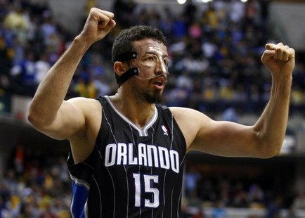Orlando Magic forward Hedo Turkoglu of Turkey celebrates near the end of Game 1 of their first round NBA Eastern Conference basketball playo