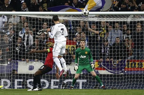 Real Madrid's Cristiano Ronaldo scores past Manchester United goalkeeper David De Gea (R) during their Champions League soccer match at Sant