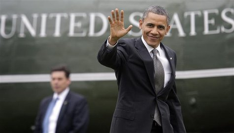 U.S. President Barack Obama waves to reporters as he returns from a daytrip in North Carolina, to the White House in Washington, February 13