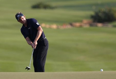 Luke Donald of England hits onto the 18th green during the fourth and final round of the DP World Tour Championship at Jumeirah Golf Estates