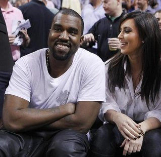 Rap musician Kanye West is seen court side with reality television star Kim Kardashian as the Miami Heat play the New York Knicks in their N