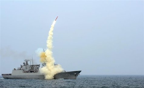 A South Korean navy destroyer launches an indigenous cruise missile during a drill at an undisclosed location in this picture released by th