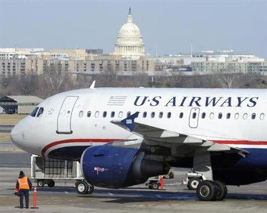 A US Airways plane arrives at the Ronald Reagan Washington National Airport in Arlington County, Virginia February 10, 2013. REUTERS/Mike Th