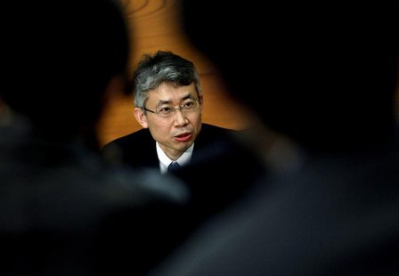 Bank of Japan (BOJ) board member Ryuzo Miyao is seen between reporters as he speaks during a news conference at the BOJ headquarters in Toky