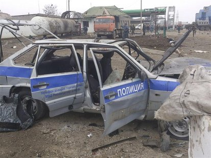 A police car is seen damaged by an explosion near a security checkpoint in the city of Khasavyurt, in the province of Dagestan, February 14,