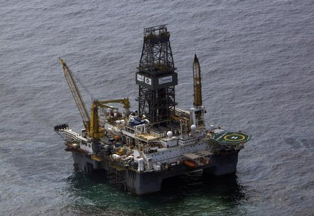 The Transocean Development Driller III, which is drilling the relief well, is seen surrounded by part of the oil slick covering the site of