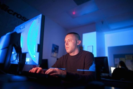 U.S. Marine Sergeant Michael Kidd works on a computer at ECPI University in Virginia Beach, Virginia, February 7, 2012. REUTERS/Samantha Sai