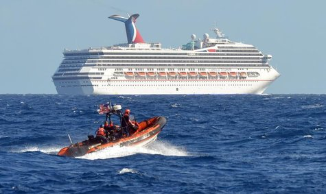A small boat from the U.S. Coast Guard Cutter Vigorous patrols near the cruise ship Carnival Triumph in the Gulf of Mexico, in this February