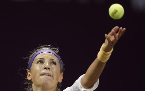Victoria Azarenka of Belarus serves the ball to Christina Mchale of U.S during their women's match at the Qatar Open tennis tournament in Do