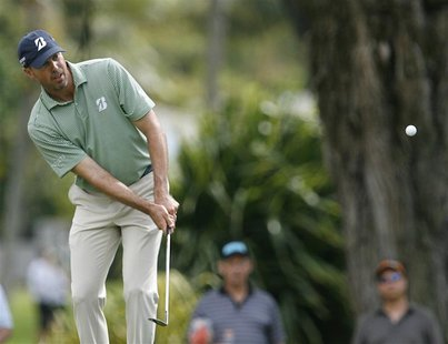 Matt Kuchar of the U.S. chips onto the fourth green during the third round of the Sony Open golf tournament in Honolulu, Hawaii January 12,