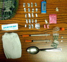 Heroin and drug paraphernalia (courtesy of FOX 11).