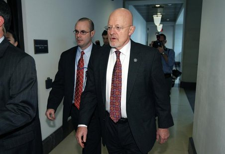 Director of National Intelligence James Clapper leaves the House Intelligence Committee after testify in a closed hearing at Capitol Hill in