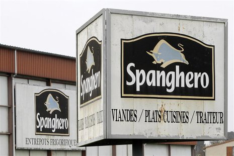 Signs with the Spanghero logo are seen at their head office in Castelnaudary, Southwestern France, February 14, 2013. REUTERS/Jean-Philippe