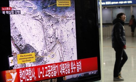 A passenger walks past a television report on North Korea's nuclear test at a railway station in Seoul February 12, 2013. REUTERS/Kim Hong-J