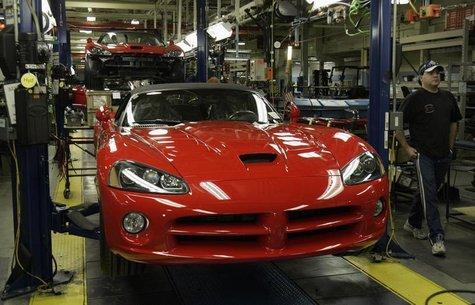 A Chrysler auto assembly worker walks past a 2008 Dodge Viper on the assembly line of the Chrysler Conner Avenue Assembly plant Detroit, Mic