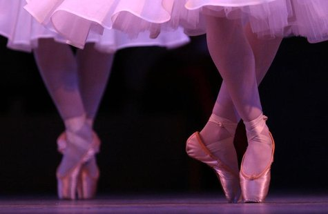 "Ballerinas perform during a dress rehearsal for the ballet ""Coppelia"" at the Royal Opera House in Covent Garden in central London in this fi"
