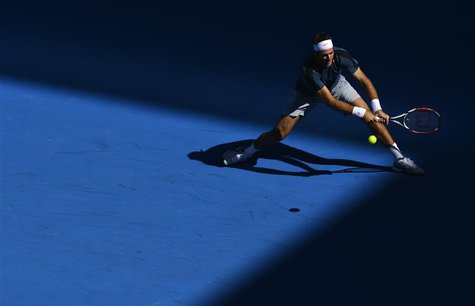 Juan Martin del Potro of Argentina hits a return to Jeremy Chardy of France during their men's singles match at the Australian Open tennis t