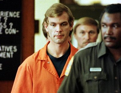 Serial killer Jeffrey Dahmer is escorted into a Milwaukee County Circuit Court by a Milwaukee County Sheriffs Deputy for his second appearan