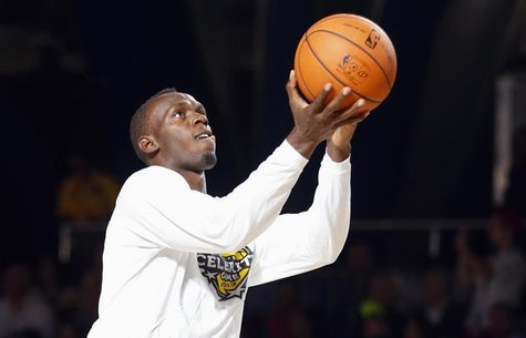 Jamaican sprinter Usain Bolt warms up before the start of the NBA All-Star celebrity basketball game in Houston, Texas, February 15, 2013. T