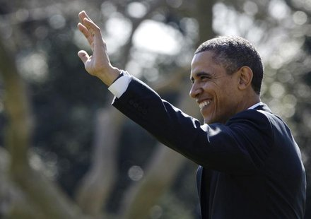 U.S. President Barack Obama waves to visitors as he departs for travel to Chicago and, eventually, a Presidents Day weekend visit in Florida