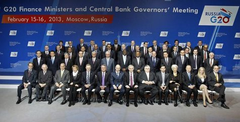 Finance ministers and central bank governors pose for a family photo during a meeting of G20 finance ministers and central bank governors at