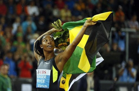 Jamaica's Shelly-Ann Fraser-Pryce celebrates as she won the women's 100m race during the Weltklasse Diamond League meeting in Zurich August