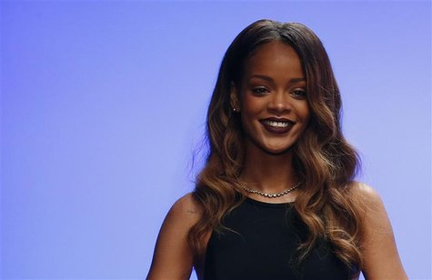 Singer Rihanna walks out onto the catwalk after the presentation of her Rihanna for River Island Autumn/Winter 2013 collection during London