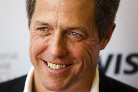 "Actor Hugh Grant arrives on the red carpet for the gala presentation of the film ""Cloud Atlas"" at the 37th Toronto International Film Festiv"