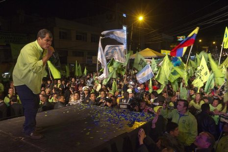 Ecuador's President Rafael Correa (L) addresses supporters during his final closing political rally in Quito February 14, 2013. Correa, one