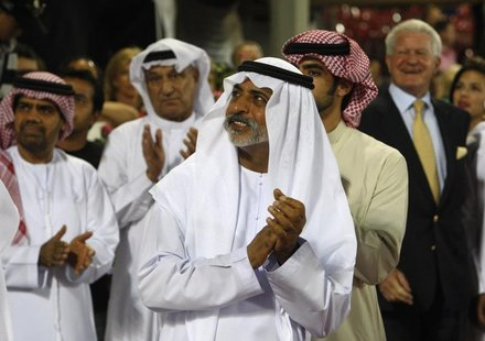 Sheikh Nahayan bin Mubarak al-Nahayan applauds the top three riders during the prize-giving ceremony of the Global Champions Tour 2011 at th