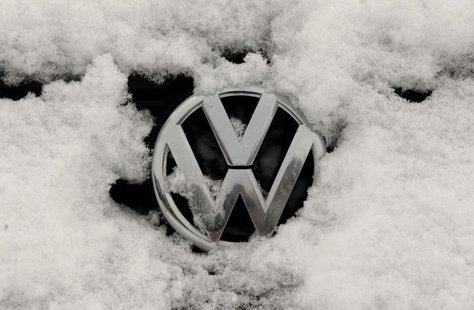 A snow-covered Volkswagen logo is pictured at a Volkswagen car dealer in the western city of Hamm January 14, 2013. REUTERS/Ina Fassbender