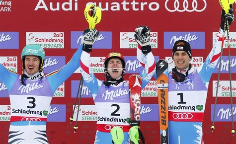 (L to R) Second placed Felix Neureuther of Germany, first placed Marcel Hirscher of Austria and third placed Mario Matt of Austria celebrate
