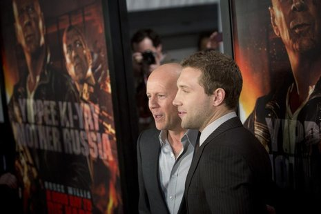 "Cast members Jai Courtney (R) and Bruce Willis meet with fans to celebrate the opening of their new film ""A Good Day To Die Hard"" in New Yor"