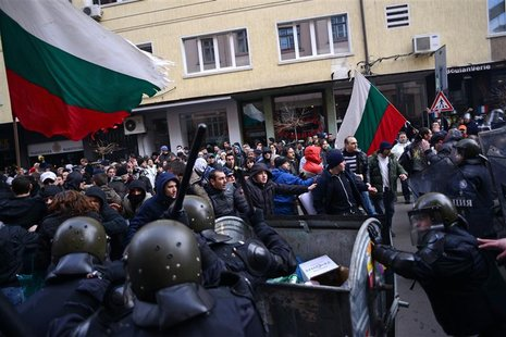 People challenge the riot police as they block traffic during a protest against high electricity bills in Sofia February 17, 2013. REUTERS/T