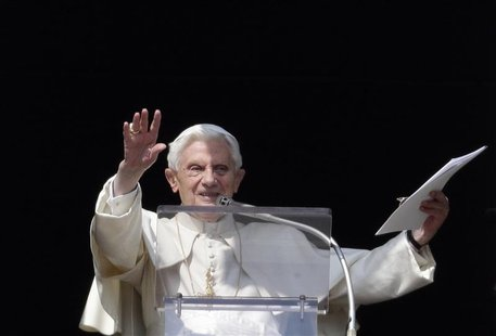 Pope Benedict XVI waves as he leads the Sunday Angelus prayer in Saint Peter's Square at the Vatican February 17, 2013. REUTERS/Max Rossi