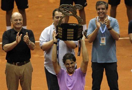 Rafael Nadal of Spain holds up the trophy after winning his final match against David Nalbandian of Argentina at the Brazil Open tennis tour