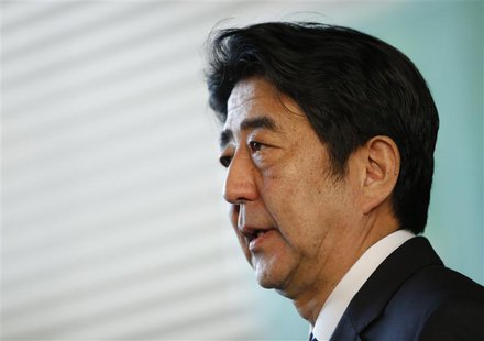 Japan's Prime Minister Shinzo Abe speaks to media after attending a meeting of Security Council of Japan at his official residence in Tokyo