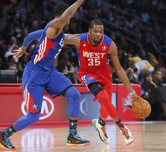 NBA All-Star Kevin Durant of the Oklahoma Thunder (35) drives the ball past All-Star Paul George of the Indianapolis Pacers during the NBA A