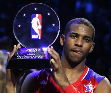 NBA All-Star Chris Paul of the Los Angeles Clippers holds up the MVP trophy after the 2013 NBA All-Star basketball game in Houston, Texas, F