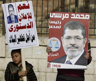 Muslim Brotherhood members and supporters of Egyptian President Mohamed Mursi chant pro-Mursi slogans, during a rally in front of the Sultan