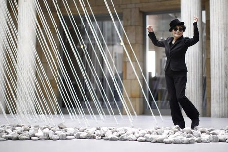 "Japanese artist Yoko Ono dances next to art pieces ""river bed and morning beams"" during the opening of the exhibition ""Half-a-wind show. A r"