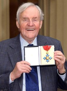 Veteran British actor Richard Briers, 69, poses with his CBE (Commander of the Order of the British Empire) medal after a ceremony with Brit